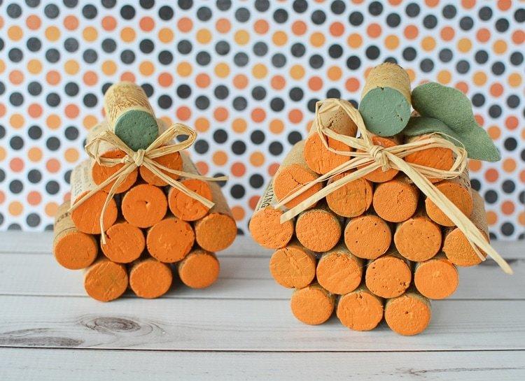 Two Wine Cork Pumpkins sitting side by side