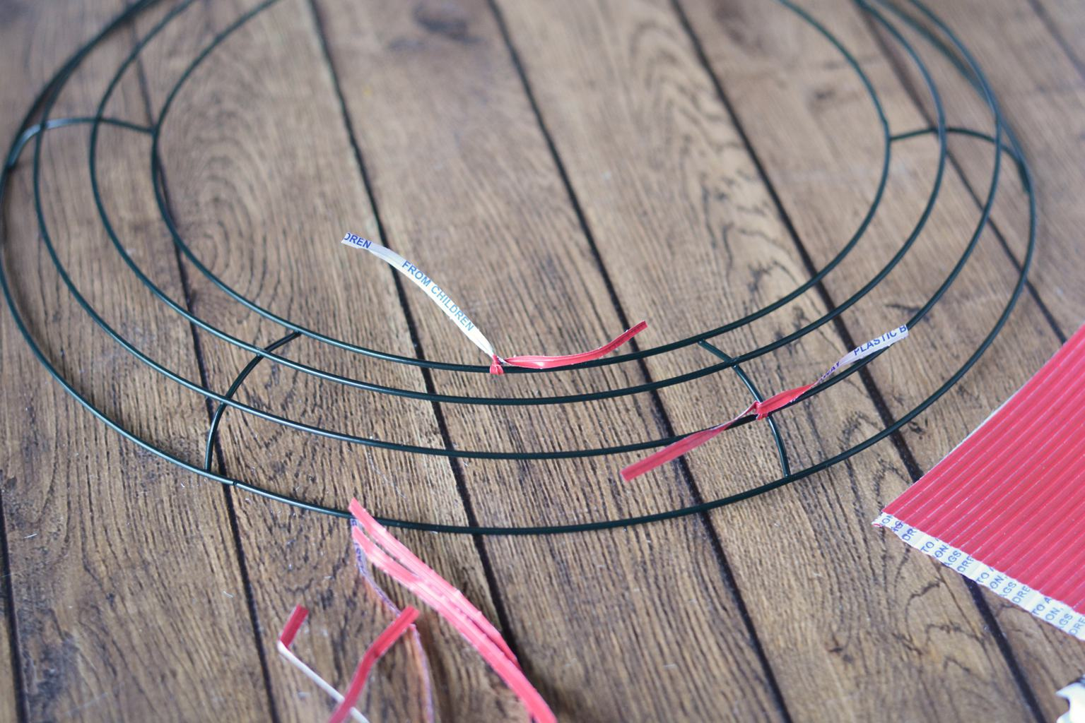 """Add twist ties to your frame. Place them about 3"""" apart and alternate/zig zag the pattern of the ties. Meaning place one on the top wire, then the second from the bottom; Place one on the second from the top and then the bottom. Twist the ties on tightly."""
