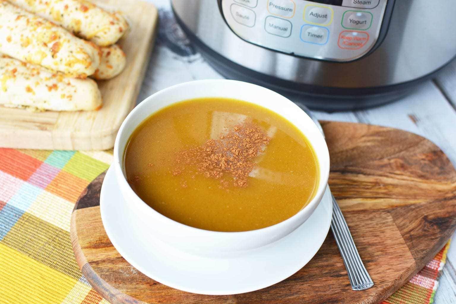 Instant Pot Butternut Squash Soup, Butternut Squash Soup next to the Instant Pot