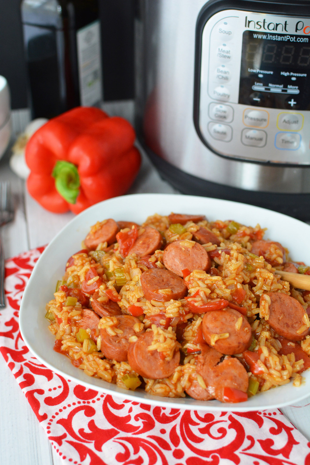 Instant Pot Jambalaya served on white dish with red bell pepper