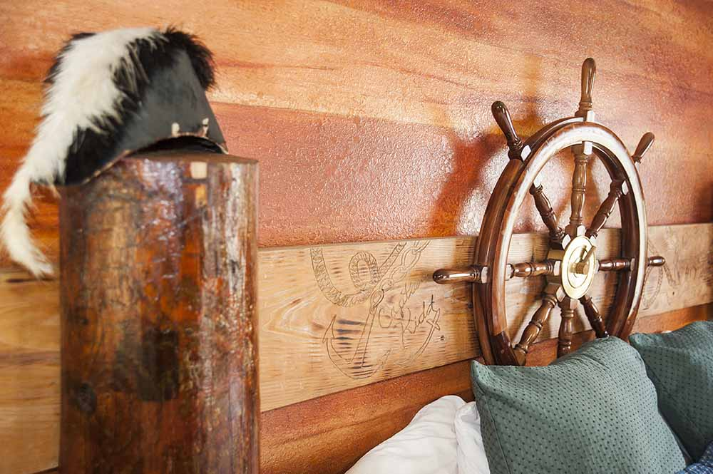 captain's quarters themed hotel room
