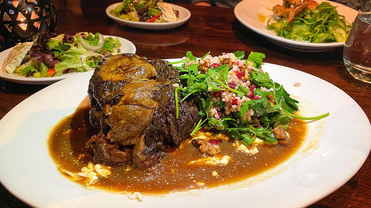 10-hour Braised Lamb Shank at Under the Cork Tree Restaurant, Sandy Springs